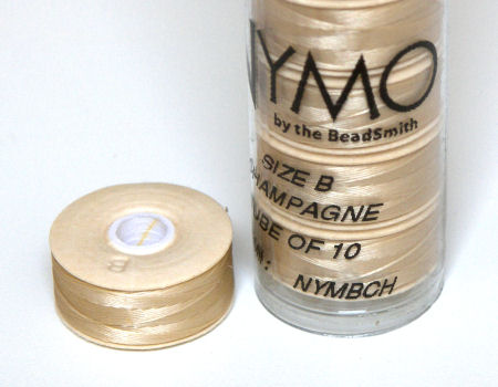 Hilo Nymo B 66metros Color: Champagne